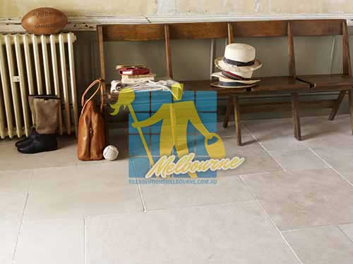 limestone tile sample storm tumbled white grout wooden chair