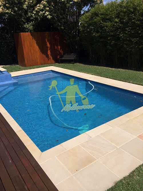 Melbourne professional cleaned sandstone around pool