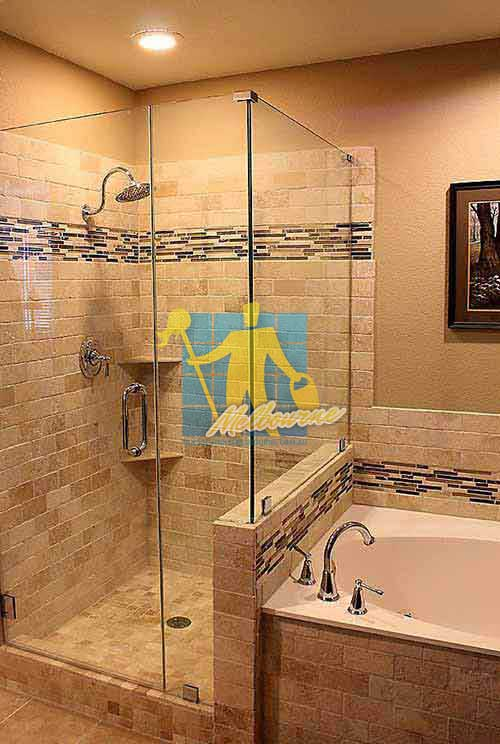 shower with marble floor and stone walls